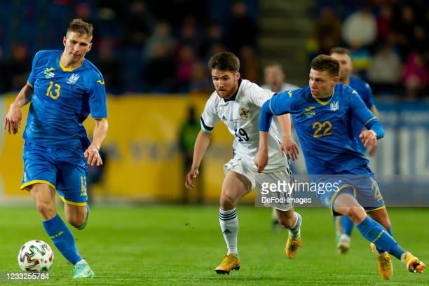 Oleksandr Syrota of Ukraine, Paul Smyth of Northern Ireland and Mykola Matvienko of Ukraine battle for the ball during the international friendly...