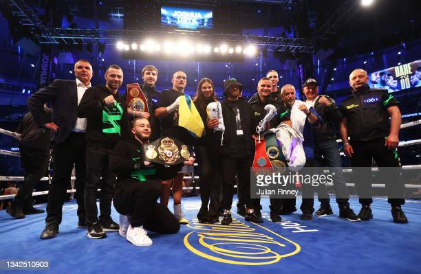 Oleksandr Usyk celebrates with their team after being crowned the new World Champion following the Heavyweight Title Fight between Anthony Joshua and...