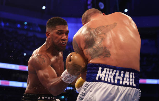 Oleksandr Usyk ducks as Anthony Joshua punches during the Heavyweight Title Fight between Anthony Joshua and Oleksandr Usyk at Tottenham Hotspur...