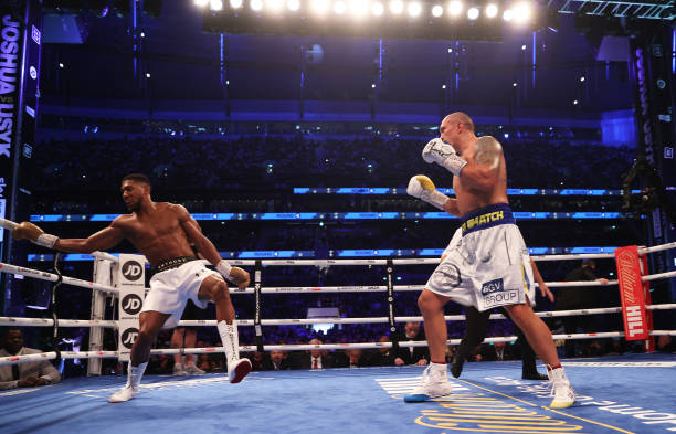 Oleksandr Usyk looks on as Anthony Joshua reacts during the Heavyweight Title Fight between Anthony Joshua and Oleksandr Usyk at Tottenham Hotspur...