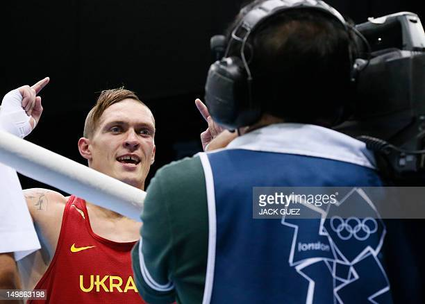 Oleksandr Usyk of the Ukraine celebrates his points decision over Artur Beterbiev of Russia in the quaterfinals Heavyweight boxing of the 2012 London...