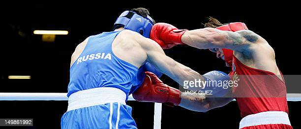 Oleksandr Usyk of the Ukraine defends against Artur Beterbiev of Russia in quaterfinals Heavyweight boxing of the 2012 London Olympic Games at the...