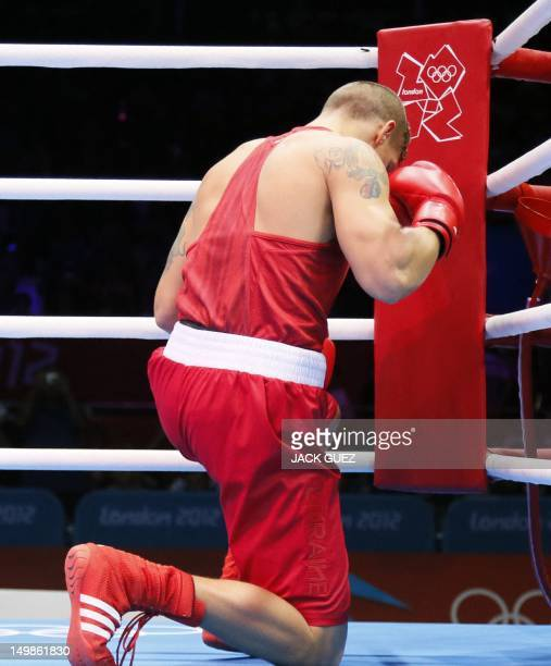 Oleksandr Usyk of the Ukraine kneels in prayer prior to the start of his match against Artur Beterbiev of Russia in quaterfinals Heavyweight boxing...