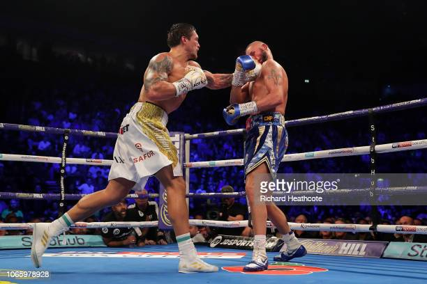 Oleksandr Usyk of Ukraine knocks out Tony Bellew of England during the WBC, WBA, WBO, IBF & Ring Magazine World Cruiserweight Title Fight between...