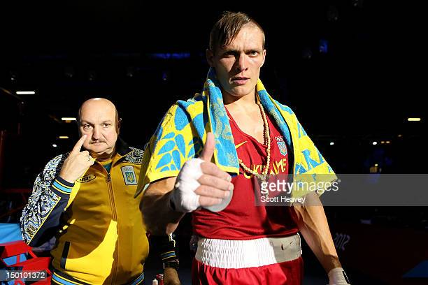 Oleksandr Usyk of Ukraine reacts after he was declared the winner against Tervel Pulev of Bulgaria during their Men's Heavy Boxing bout on Day 14 of...