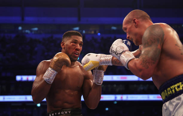 Oleksandr Usyk punches as Anthony Joshua ducks during the Heavyweight Title Fight between Anthony Joshua and Oleksandr Usyk at Tottenham Hotspur...