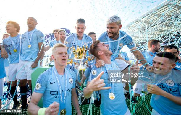 Oleksandr Zinchenko Ederson Aymeric Laporte Sergio Aguero and Phil Foden celebrate with the Premier League trophy after the Premier League match...