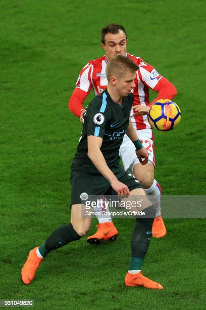 Oleksandr Zinchenko of Man City battles with Xherdan Shaqiri of Stoke during the Premier League match between Stoke City and Manchester City at the...