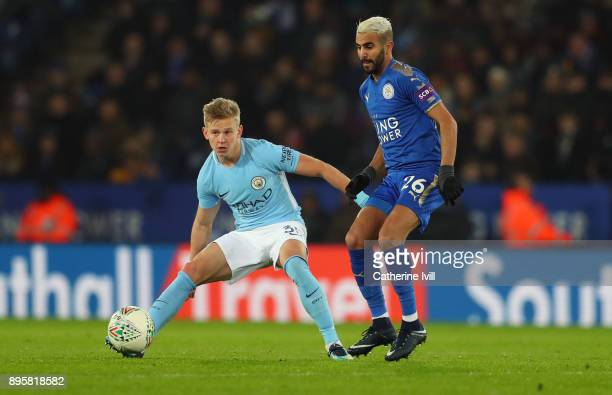Oleksandr Zinchenko of Manchester City and Riyad Mahrez of Leicester City during the Carabao Cup QuarterFinal match between Leicester City and...