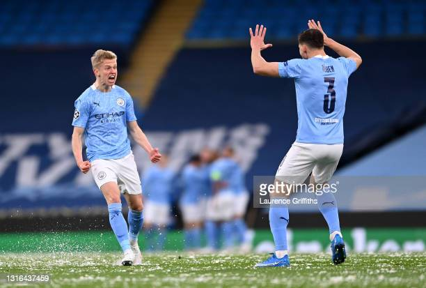 Oleksandr Zinchenko of Manchester City and Ruben Dias celebrate the first goal scored by Riyad Mahrez during the UEFA Champions League Semi Final...
