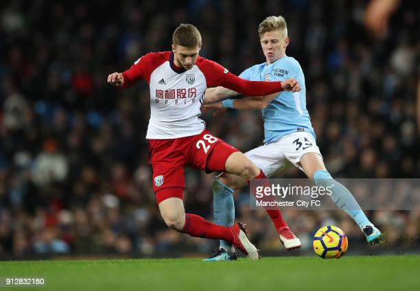 Oleksandr Zinchenko of Manchester City and Sam Field of West Bromwich Albion during the Premier League match between Manchester City and West...