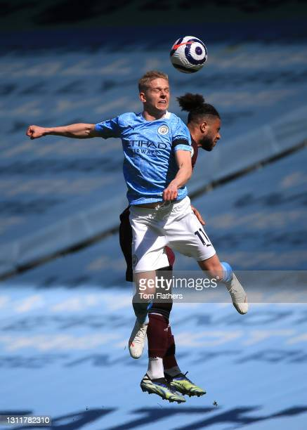 Oleksandr Zinchenko of Manchester City and Tyler Roberts of Leeds United battle for the ball during the Premier League match between Manchester City...