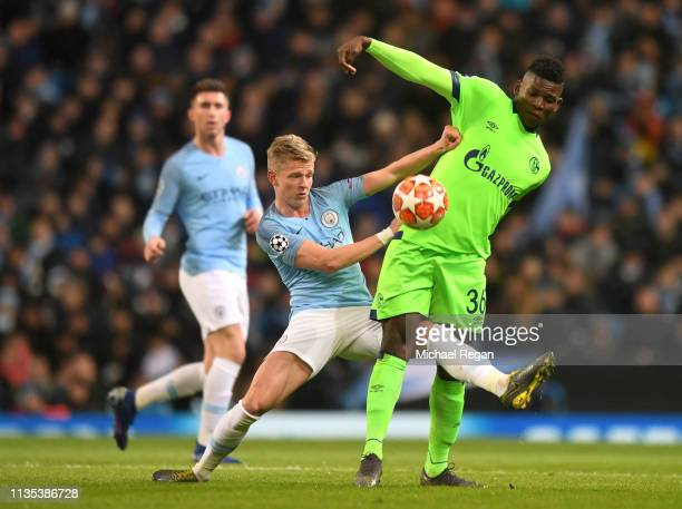 Oleksandr Zinchenko of Manchester City battles for possession with Breel Embolo of FC Schalke 04 during the UEFA Champions League Round of 16 Second...
