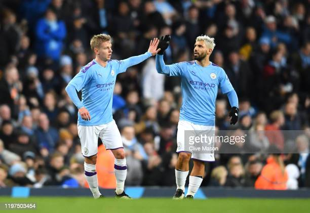 Oleksandr Zinchenko of Manchester City celebrates after scoring his team's first goal wit teammate Sergio Aguero during the FA Cup Third Round match...