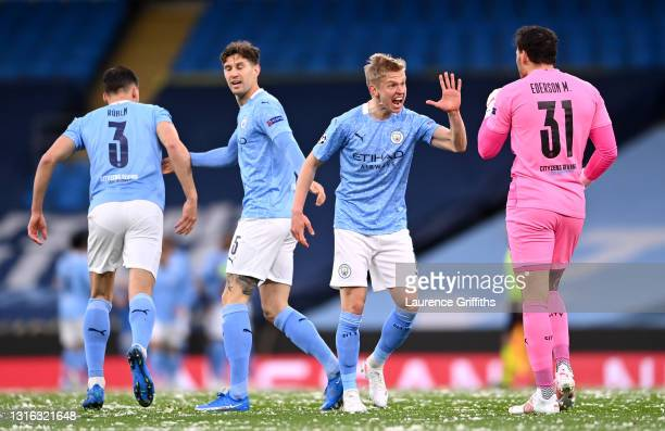 Oleksandr Zinchenko of Manchester City celebrates his side's first goal which came from a Riyad Mahrez goal with Ederson of Manchester City during...