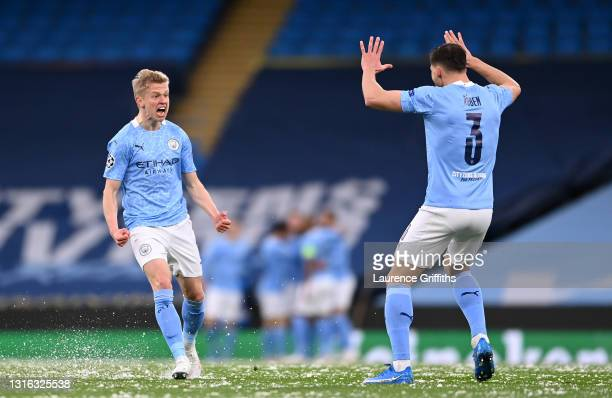 Oleksandr Zinchenko of Manchester City celebrates his side's first goal which came from a Riyad Mahrez goal with Ruben Dias during the UEFA Champions...