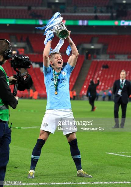 Oleksandr Zinchenko of Manchester City celebrates with the trophy following victory in the Carabao Cup Final between Chelsea and Manchester City at...
