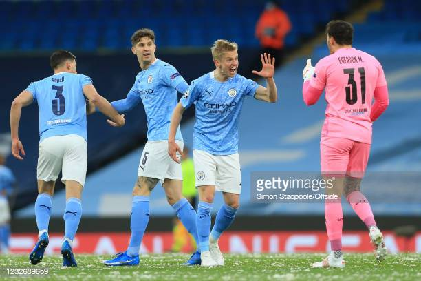 Oleksandr Zinchenko of Manchester City congratulates goalkeeper Ederson on his assist for the first City goal during the UEFA Champions League Semi...
