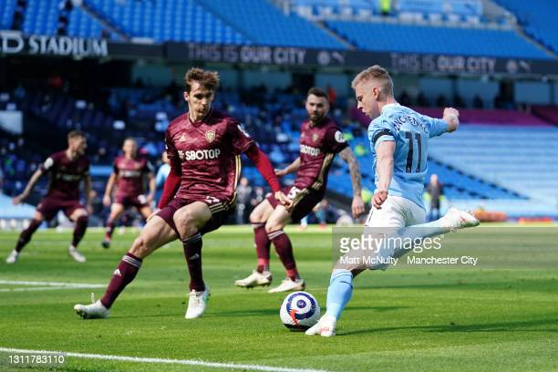 Oleksandr Zinchenko of Manchester City crosses the ball past Diego Llorente of Leeds United during the Premier League match between Manchester City...