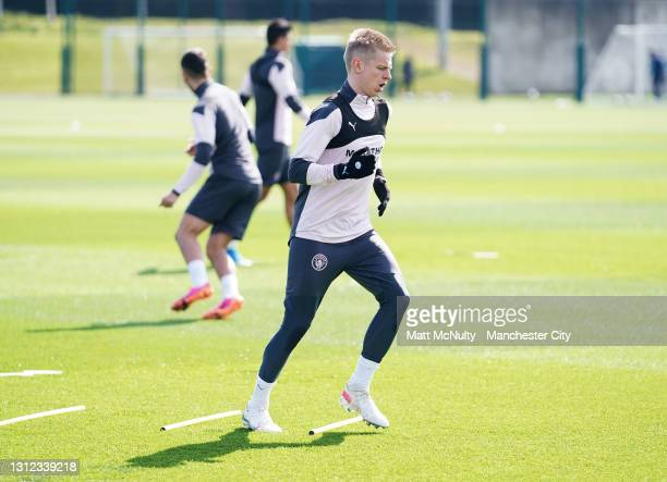 Oleksandr Zinchenko of Manchester City in action during a training session at Manchester City Football Academy on April 13, 2021 in Manchester,...