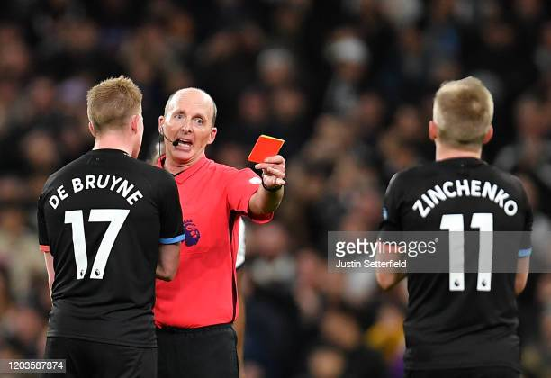 Oleksandr Zinchenko of Manchester City is shown a red card by referee Mike Dean during the Premier League match between Tottenham Hotspur and...