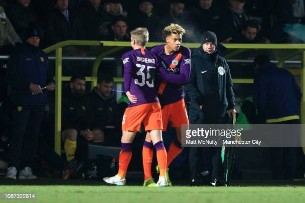 Oleksandr Zinchenko of Manchester City is substituted for Felix Nmech of Manchester City during the Carabao Cup Semi Final Second Leg match between...