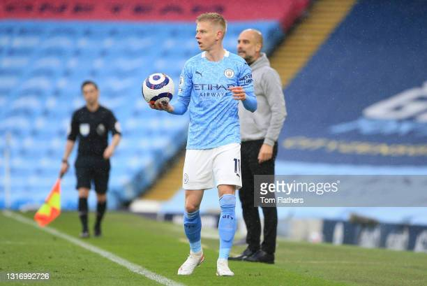Oleksandr Zinchenko of Manchester City looks on as he prepares to take a throw in during the Premier League match between Manchester City and Chelsea...