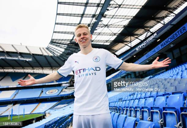 Oleksandr Zinchenko of Manchester City models the 2021-22 season away kit at the Etihad Stadium on July 29, 2021 in Manchester, England.