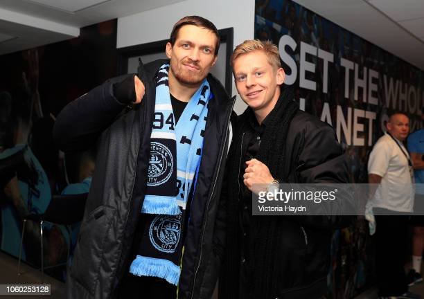 Oleksandr Zinchenko of Manchester City poses for a picture with Cruiserweight World Champion Boxer Oleksandr Usyk after the Premier League match...