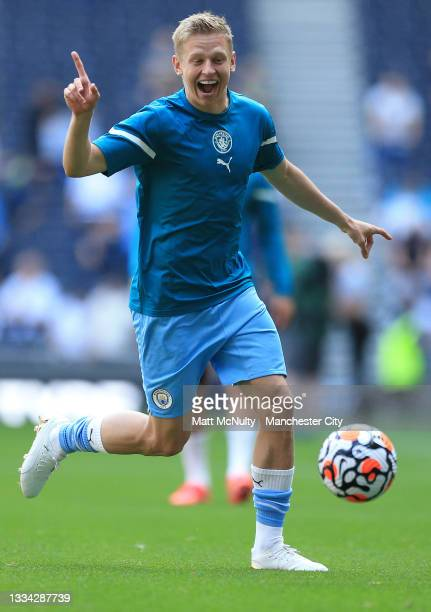 Oleksandr Zinchenko of Manchester City reacts as he warms up prior to the Premier League match between Tottenham Hotspur and Manchester City at...