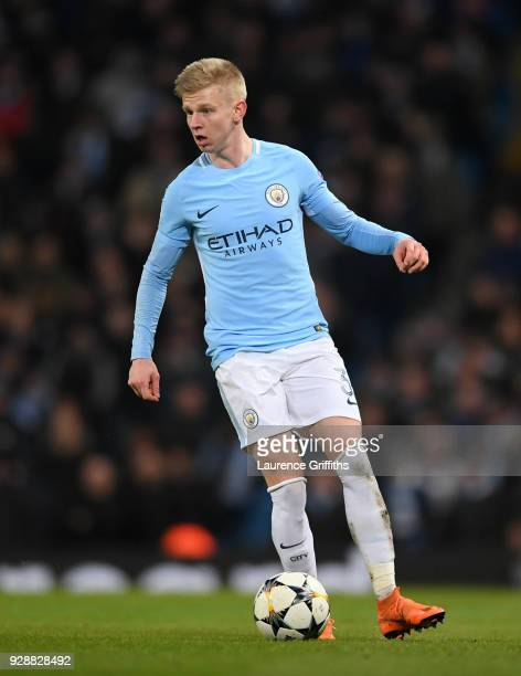 Oleksandr Zinchenko of Manchester City runs with the ball during the UEFA Champions League Round of 16 Second Leg match between Manchester City and...