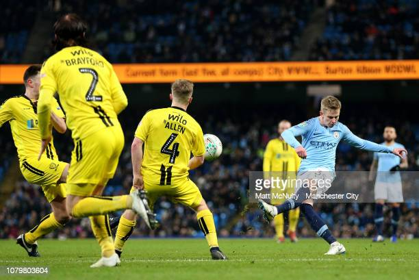 Oleksandr Zinchenko of Manchester City scores his team's fourth goal during the Carabao Cup Semi Final First Leg match between Manchester City and...