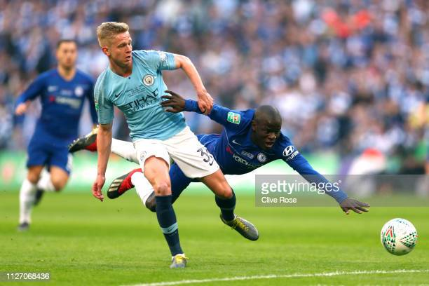 Oleksandr Zinchenko of Manchester City tackles N'golo Kante of Chelsea during the Carabao Cup Final between Chelsea and Manchester City at Wembley...