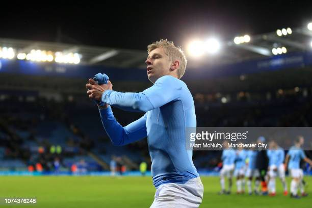 Oleksandr Zinchenko of Manchester City throws his shirt into the crowd after his team win the Carabao Cup Quarter Final match between Leicester City...