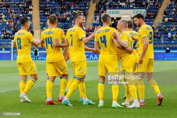 Oleksandr Zinchenko of Ukraine celebrates after scoring his team's second goal with teammates during the international friendly match between Ukraine...
