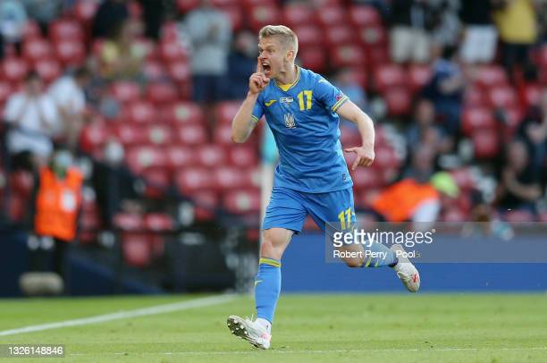 Oleksandr Zinchenko of Ukraine celebrates after scoring their side's first goal during the UEFA Euro 2020 Championship Round of 16 match between...