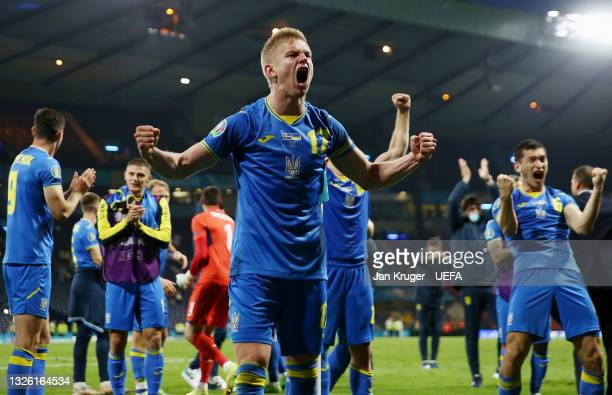 Oleksandr Zinchenko of Ukraine celebrates their side's victory with team mates after the UEFA Euro 2020 Championship Round of 16 match between Sweden...