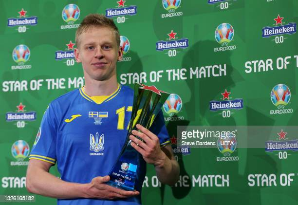 """Oleksandr Zinchenko of Ukraine poses for a photograph with their Heineken """"Star of the Match"""" award after the UEFA Euro 2020 Championship Round of 16..."""