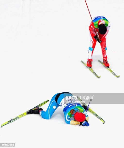 Oleksandra Kononova collapses as she wins gold with Shoko Ota of Japan in second place in the Women's 1km Standing CrossCountry Sprint Final during...