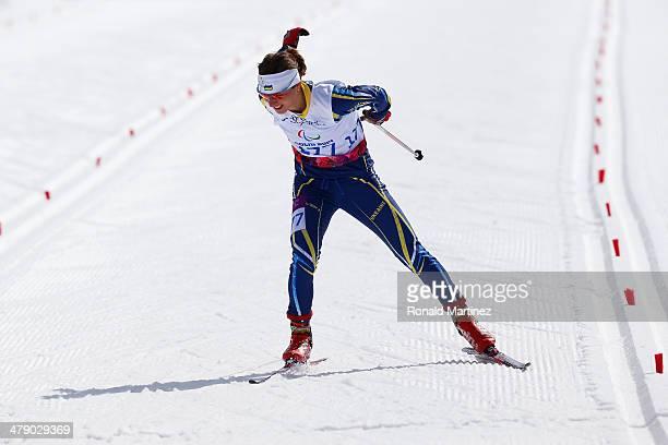 Oleksandra Kononova of Ukraine crosses the finish line in the Women's Cross Country 5km Free – Standing on day nine of the Sochi 2014 Paralympic...