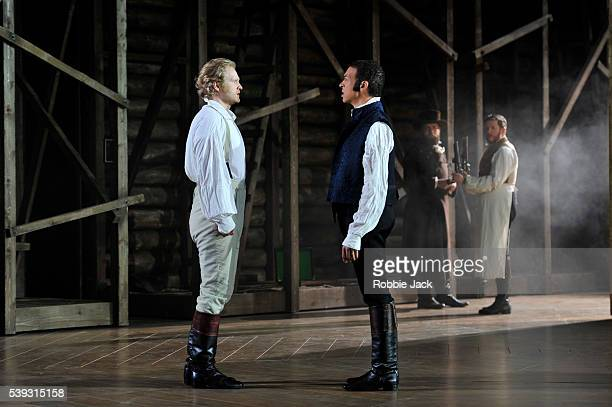 Oleksiy Palchykov as Lensky and Roderick Williams as Eugene Onegin with artists of the company in Garsington Opera's production of Pyotr Ilyich...
