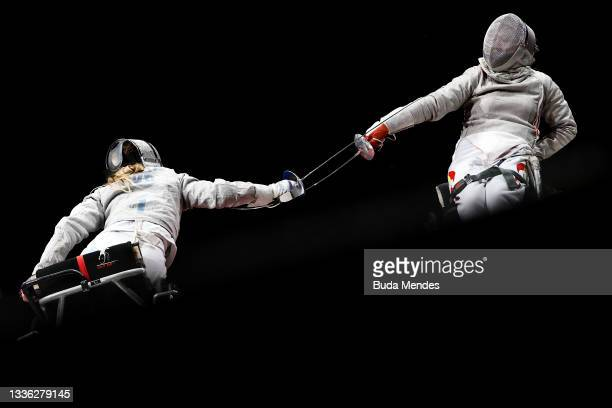 Olena Fedota of Team Ukraine competes Shumei Tan of Team China during the Women's Sabre Individual Category B Final on day 1 of the Tokyo 2020...