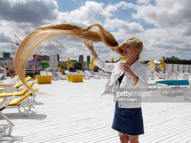 Olena Korzenyuk who is a record holder for teenager with the longest hair in Ukraine, shows her 2.35 m long hair during an event of the National...