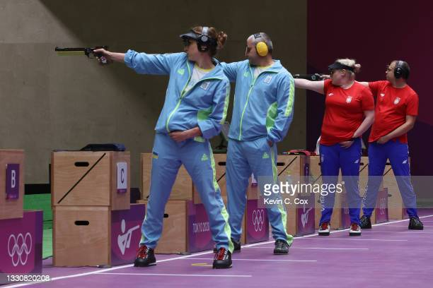 Olena Kostevych and Oleh Omelchuk of Team Ukraine and Zorana Arunovic and Damir Mikec of Team Serbia during the 10m Air Pistol Mixed Team Bronze...