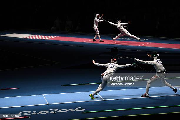 Olena Kryvytska of Ukraine competes against Yiwen Sun of China and Injeong Choi of Korea competes against Julia Beljajeva of Estonia during Women's...