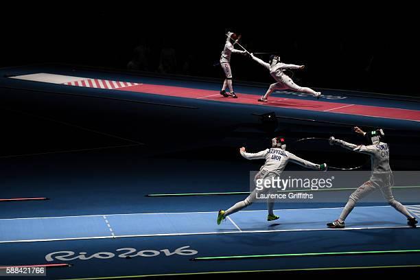 Olena Kryvytska of Ukraine competes against Yiwen Sun of China and Injeong Choi of Korea competes against Julia Beljajeva of Estonia during Women's...