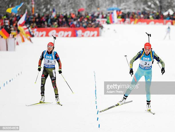 Olena Pidhrushna of the Ukraine crosses the line ahead of Laura Dahlmeier of Germany in the Women's 4x 6km relay on Day 5 of the IBU Biathlon WOrld...