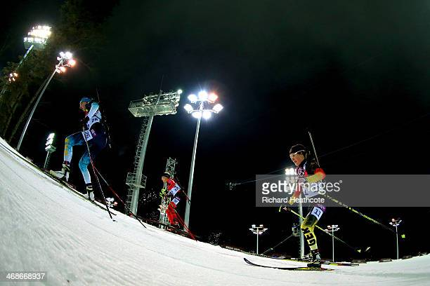 Olena Pidhrushna of Ukraine and Evi SachenbacherStehle of Germany compete in the Women's 10 km Pursuit during day four of the Sochi 2014 Winter...
