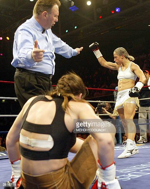 Olena Tverdokhlib of Ukraina lies on the canvas while being defeated by Myriam Lamare of France during their professional women Superlight Weight...