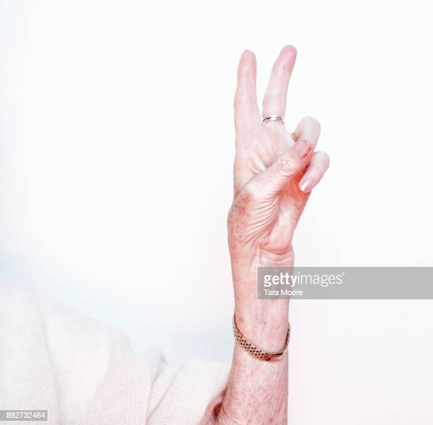 oler hand holding peace sign